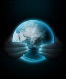 Monde dans des mains Illustration de Vecteur