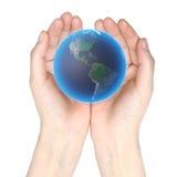 Monde dans des mains Images stock
