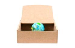 Monde dans la boîte en bois Photo libre de droits
