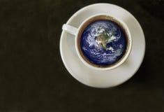 Monde dans une tasse Photographie stock libre de droits