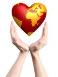 Monde de coeur dans des mains Photo stock