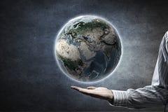 Monde entier dans des mains Image stock