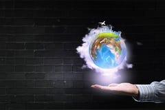 Monde entier dans des mains Photo stock