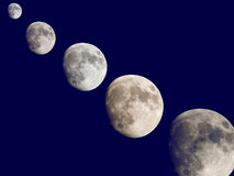 Mondeinstellung im blauen Himmel Stockbilder