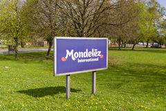 Mondelez Factory Sign. Mondelez International sign outside the cocoa bean processing factory where chocolate is made. The site was formerly part of the Cadbury Royalty Free Stock Photos