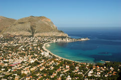 Mondello. Is a small town near the city of Palermo in Sicily in Southern Italy. The beach lies between two cliffs called Monte Gallo and Monte Pellegrino. The Stock Photos