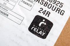 Mondial-Relaisaufkleber auf cardbox Lizenzfreie Stockbilder