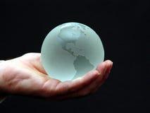 Mondo di vetro in sua mano Immagine Stock Libera da Diritti