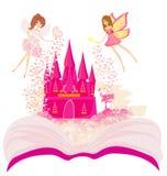 Mondo magico dei racconti, castello leggiadramente che compare dal libro Immagine Stock