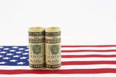 Moneda americana en bandera de los E.E.U.U. Foto de archivo libre de regalías