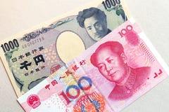 Moneda asiática, China y Japón Imágenes de archivo libres de regalías