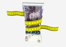 moneda BRITÁNICA 3D con los pares de tijeras Foto de archivo