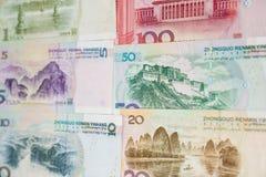 Moneda china y calculadora Imagen de archivo libre de regalías
