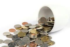 Moneda con la taza Imágenes de archivo libres de regalías
