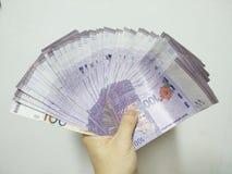 Moneda de las finanzas que entrega el dinero Malasia imagen de archivo libre de regalías