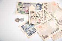Moneda de los billetes de banco de los yenes japoneses y de los yenes japoneses Imagenes de archivo