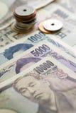 Moneda de los yenes japoneses Imagenes de archivo