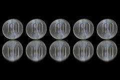 Moneda de los yenes japoneses en negro Imagen de archivo libre de regalías