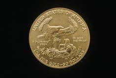 Moneda de oro del águila Fotos de archivo libres de regalías