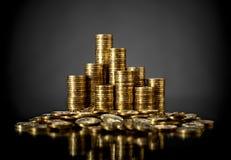 Moneda de oro del cartucho de dinero Fotos de archivo