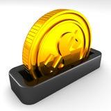 Moneda de oro en la ranura de un moneybox Imagenes de archivo