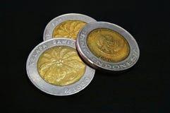 Moneda de oros de Indonesia Fotos de archivo libres de regalías