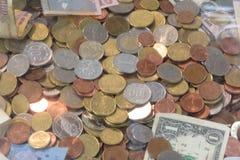 Moneda de países diffreent Foto de archivo libre de regalías