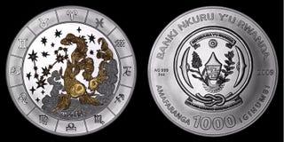 Moneda de plata que representa las muestras del zodiaco Foto de archivo