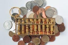 Moneda del ábaco y del dinero Fotografía de archivo libre de regalías