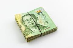 Moneda del baht tailandés con el billete de banco, dinero tailandés Fotografía de archivo libre de regalías