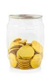 Moneda del chocolate del oro en botella Fotos de archivo