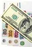 Moneda del dólar de la rublo Imágenes de archivo libres de regalías