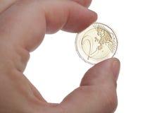 Moneda del euro de la mano Imágenes de archivo libres de regalías