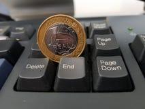 Moneda despreciada fotografía de archivo