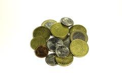 Moneda en el fondo blanco Fotografía de archivo libre de regalías