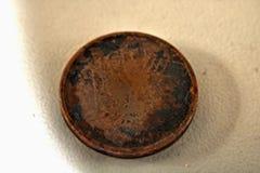 Moneda en fondo granoso imagen de archivo libre de regalías