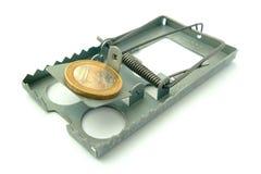 Moneda en la ratonera Fotografía de archivo