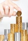 Moneda en la tapa de la pila Imagen de archivo libre de regalías