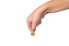 Moneda en mano femenina Foto de archivo libre de regalías