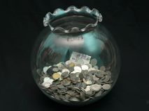 Moneda en tarro Foto de archivo
