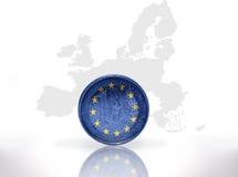 Moneda euro con la bandera de unión europea Fotos de archivo