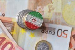 Moneda euro con la bandera nacional de Irán en el fondo euro de los billetes de banco del dinero Imagen de archivo
