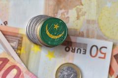 Moneda euro con la bandera nacional de Mauritania en el fondo euro de los billetes de banco del dinero Fotografía de archivo libre de regalías