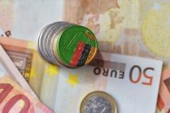 Moneda euro con la bandera nacional de Zambia en el fondo euro de los billetes de banco del dinero Fotos de archivo libres de regalías