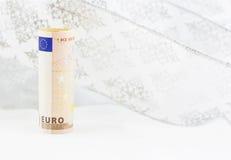 Moneda euro en remolino del fondo blanco Foto de archivo