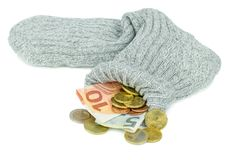 Moneda euro en un calcetín viejo Fotos de archivo libres de regalías