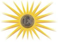 Moneda euro inscrita en el sol Imágenes de archivo libres de regalías