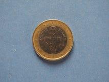 1 moneda euro, unión europea, Chipre sobre azul Foto de archivo libre de regalías