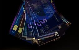Moneda euro y x28; billetes de banco y x29; en la protección de la luz UV Foto de archivo