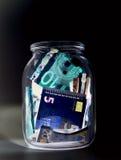 Moneda euro y x28; billetes de banco y x29; en la protección de la luz UV Imagenes de archivo